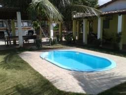 Procuro Granja ou casa com piscina