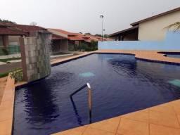 Casa nova em condomínio 2 quartos, banheiro, sala e cozinha, blindex, laje e piscinas