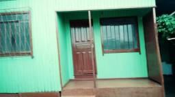 Aluga-se casa de madeira