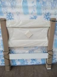 Cama branca de solteiro, nova na embalagem