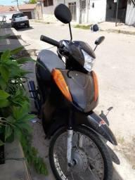 Troco Moto Biz 100 semi nova em terreno ou dou de entrada em uma casa