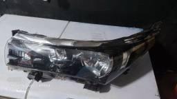 Farol esquerdo Toyota corolla