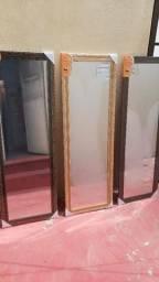 Espelho grande cada um a $100 Mas inf *