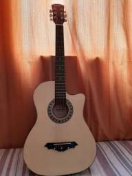 Troco violão por outro melhor e volto dinheiro