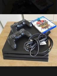 PlayStation 4 pro + 2 controles + street fighter V - super conservado 4 meses de uso