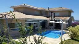 Casa com 4 dormitórios à venda, 403 m² por R$ 1.950.000 - Condomínio Reserva do Paratehy -
