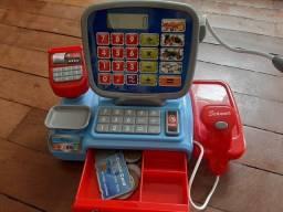 Máquina registradora com cartão e moedas