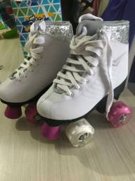 Vendo patins 4 rodas com led