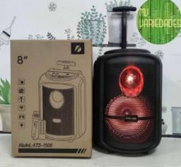 Caixa de som com controle e microfone puxador e rodinha ( ENTREGA GRÁTIS)