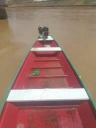 Vendo canoa e motor novos *