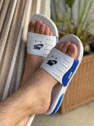 2 Pares de Chinelos Nike