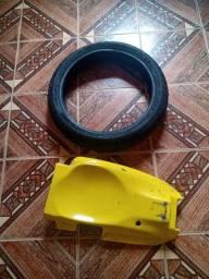 Vendo 1 pneu dianteiro da hornet 2006 E um eliminador de placa
