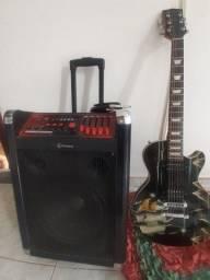 Caixa amplificadora e guitarra