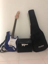 Guitarra com caixa amplificadora