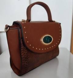 Bolsa de mão em couro marron