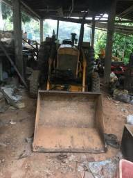 Trator com concha grade roçadeira arado