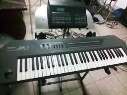 Teclado JX-1 Roland e Mid Kawai