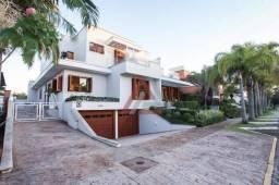 Casa com 5 dormitórios à venda, 538 m² por R$ 4.500.000,00 - Jurerê Internacional - Floria