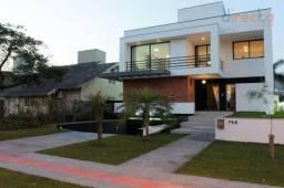 Casa com 4 dormitórios à venda, 400 m² por R$ 2.800.000,00 - Jurerê Internacional - Floria