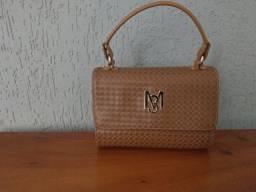 Bolsa Mônica Sanches tiracolor e de mão