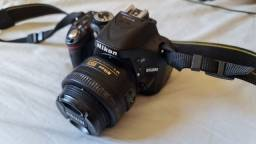 Nikon D5200 + Bateria externa + lente