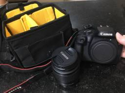 Canon T100 - Câmera DSLR