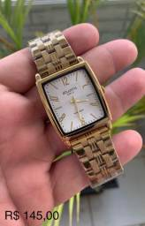 Lindo relógio Atlantis dourado fundo branco. Só chamar e enviamos todos os modelos.