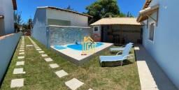 JR-Linda casa lado praia, com 3 quartos área gourmet e piscina.