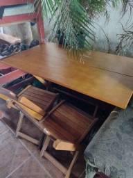 Vendo uma mesa de 6 cadeira por 500  reais comprei por 850