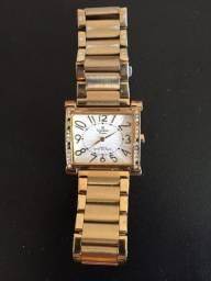Vendo relógio dourado