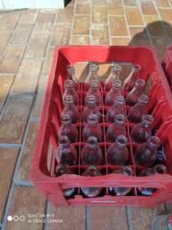 Cascos garrafas de refirgetante Coca cola