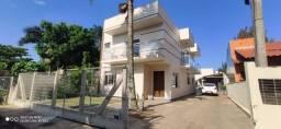 Casa 4 dormitórios com suíte beira do Rio Mampituba