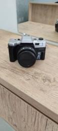 Camera fotógrafica na caixa com manual