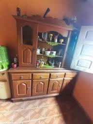 Estou vendendo uma estante um armário de Madeira, sofá de couro