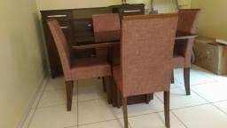 Vende-se mesa de vidro com 4 cadeiras, nova, zerada, só foi montada