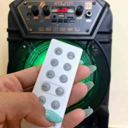 Caixa de som KTS 1131 com controle e microfone ??: