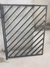 Portão de grade de ferro