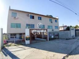Apartamento triplex com dois dormitórios, dois banheiros e garagem.