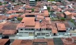 Prédio com 3 casas para venda no bairro Feira X