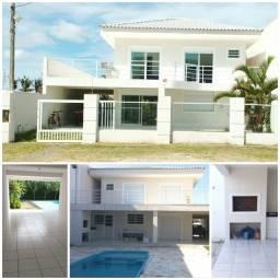 Casa para alugar de Frente para o Mar em Guaratuba c/ Piscina, Churrasqueira e 4 Suites