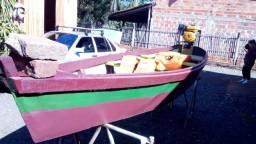 Barco artesanal e motor Buffalo