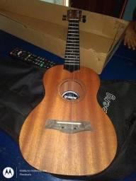 Vendo este ukulele acústico nunca usado ou troco por sofá