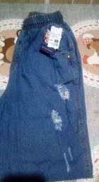 Vendo conjunto saia e coop tamanho m vermelho novo e uma calça jean nova