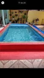 Venda de casa nova com 3 quartos, uma suíte e mais dois banheiros é ótima piscina