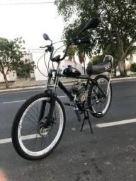Bicicleta motorizada preta semi nova