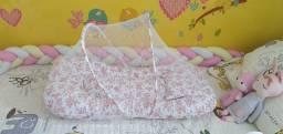 Ninho de bebê com cortinado