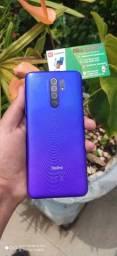 Promoção Xiaomi Redmi 9 64gb/4gb Com 6 Meses De Garantia Cor Verde/Roxo