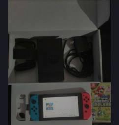 Nintendo Switch + New Super Mario Bros Deluxe