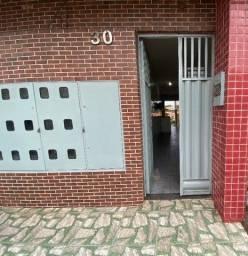 Kitnet com sala/cozinha conjugada, 1 suíte e área de serviço, para alugar