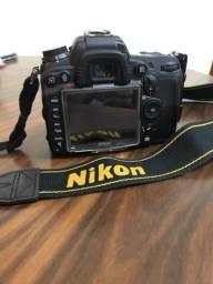 Câmera Nikon d700 com flash é lente